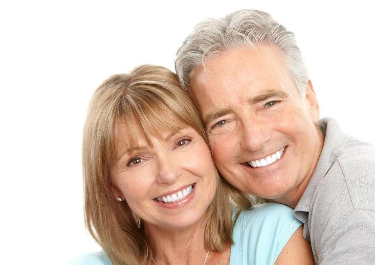 an older couple smiles | coffs harbour dental office