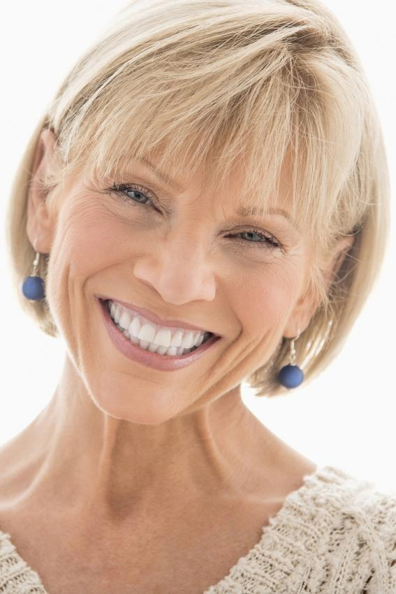 an older woman smiles | dentist coffs harbour