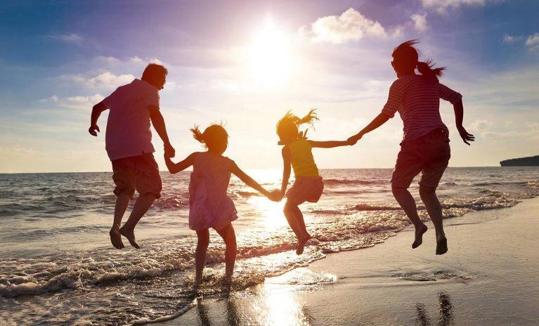 Family Playing on Beach | Dentist Coffs Harbour