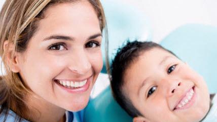 a woman and a boy smile | family dentist coffs harbour