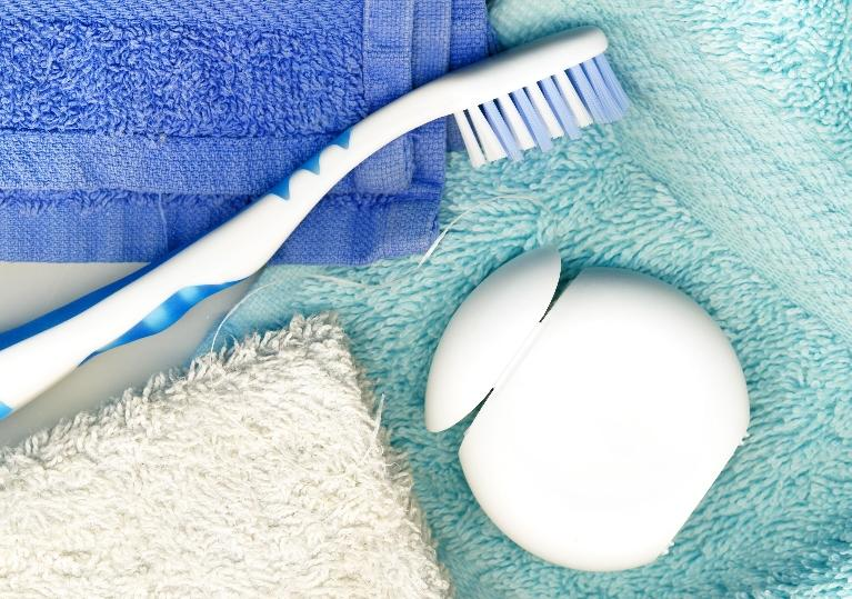 a toothbrush and floss | dentist coffs harbour